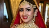 Sayyeshaa is a princess walking to the mandap for wedding with Arya. Watch video