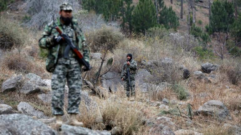 Pakistani soldiers guard the Balakot area where IAF jets carried out the air strikes. (Image: Reuters)