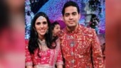 Akash Ambani and Shloka Mehta go all red at wedding reception. What newlyweds wore