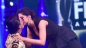 Deepika Padukone kisses Ranveer Singh after he goes down on one knee at award show. Watch video