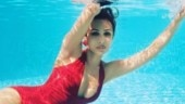 Malaika Arora turns up the heat as she gets into a pool in hot red monokini