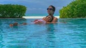 Abhishek Bachchan posts pretty photo of Aishwarya and Aaradhya chilling in pool in Maldives