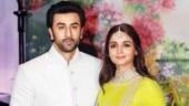 Ranbir Kapoor shares an awkward kiss with Alia Bhatt at award show. See viral video
