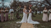 Former women's Big Bash League club teammates Jensen and Hancock get hitched