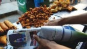 Students wearing graduation robes detained for selling Modi pakodas near PM's rally venue