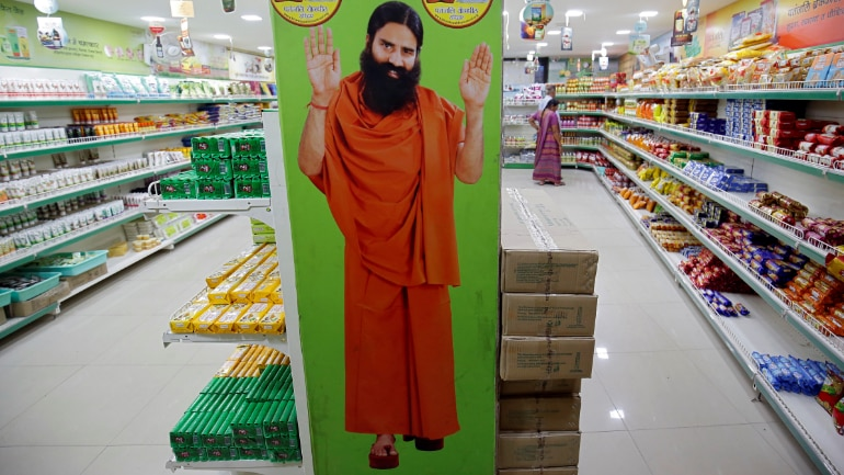 A hoarding with an image of Baba Ramdev is seen inside a Patanjali store in Ahmedabad. (Photo: Reuters)