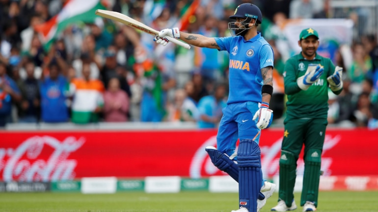 Virat Kohli gestures towards the crowd after reaching fifty against Pakistan