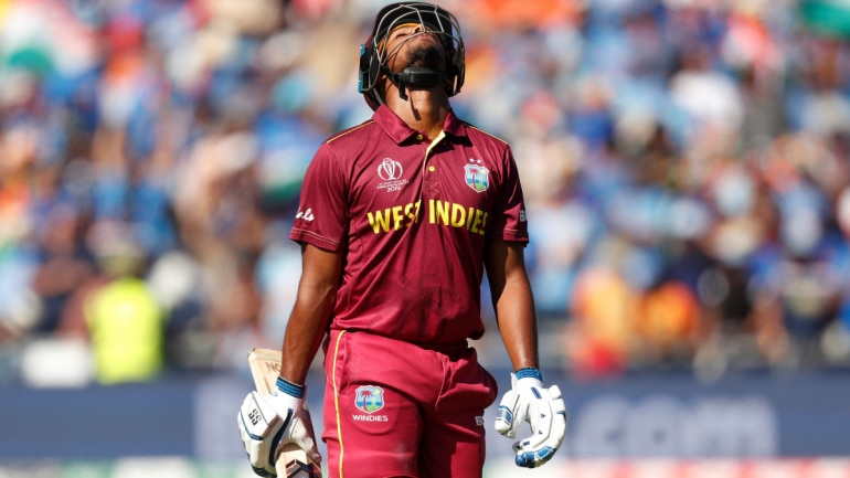 Nicholas Pooran looks dejected as he walks off after losing his wicket
