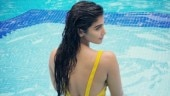 Waterbaby Pooja Hegde raises the temperature in yellow bikini. See pic