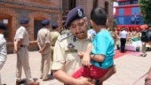 Srinagar SSP breaks down as he carries martyred cop's son at wreath-laying ceremony