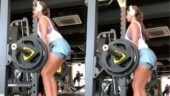 Disha Patani flaunts toned figure in mini shorts and backless top while lifting 63 kgs in gym