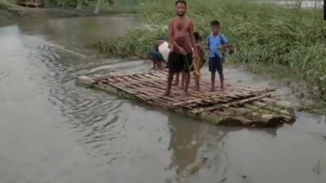 Rains in Bhutan raise river water level in Assam's Tamulpur, bridge washes away