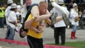 Couple wins wife carrying world championship, gets wife's weight in beer as prize