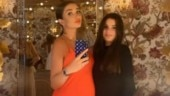 Pregnant Amy Jackson flaunts baby bump in orange gown with plunging neckline. See pic