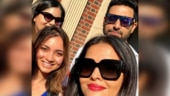 Aishwarya Rai and Abhishek Bachchan soak up the sun in NYC with fans. See pic