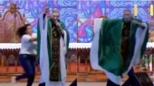Watch: Woman pushes priest off stage for saying fat women don't go to heaven. Twitter calls her hero