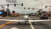 Car camera records dramatic landing by airplane on busy US road. Video goes viral, of course