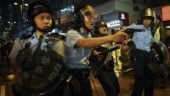 Hong Kong police draw guns, arrest 36 from latest protest