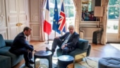 Boris Johson lets his hair down, puts his feet up at Macron's palace