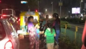 Girl distributes biscuits to kids at Ahmedabad traffic signal. Internet is in love