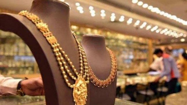Gold prices up marginally; silver tumbles by Rs 590 per kg - Business News