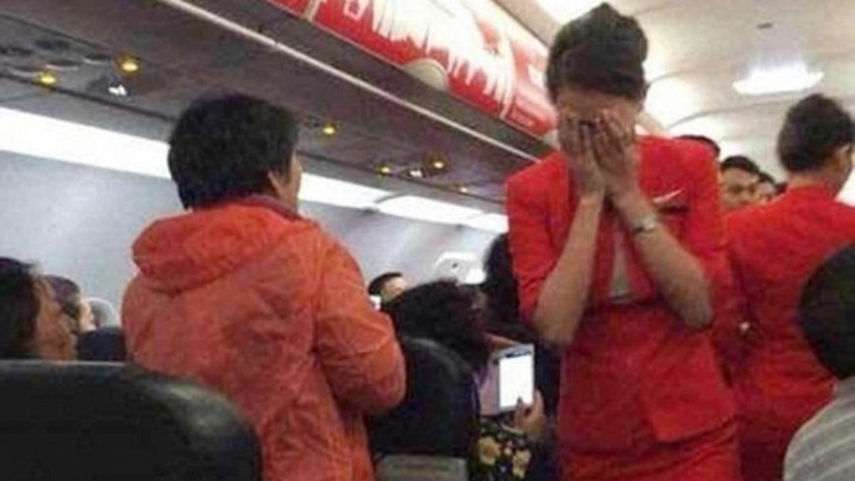 A Chinese flyer threw hot water at air hostess on Air Asia
