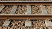 Why are there stones on railway tracks?