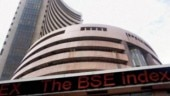 Sensex down 218 points, RIL up 9 per cent