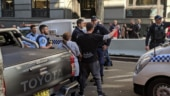 Man goes on stabbing spree on busy Sydney street, locals catch him with chairs, bare hands