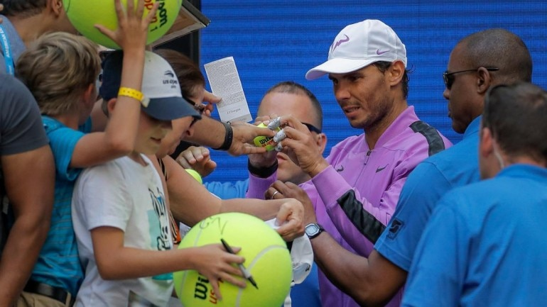 US Open: Rafael Nadal picks up crying kid from crowd