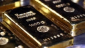 Gold dips to near one-month low, down by 0.3%