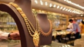Gold drops by Rs 215 on strong rupee, tepid global cues