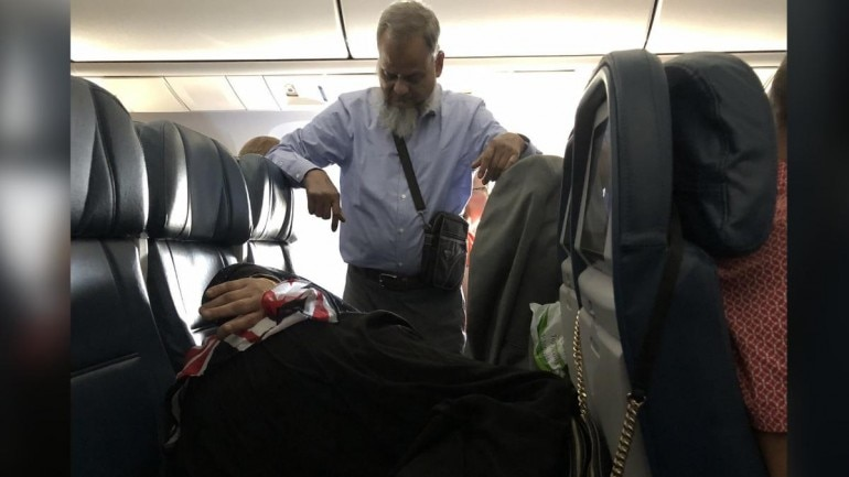 Pic of man standing 6 hours on flight to let wife sleep goes viral