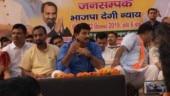 Delhi BJP chief Manoj Tiwari shaves on stage at public meeting in Burari