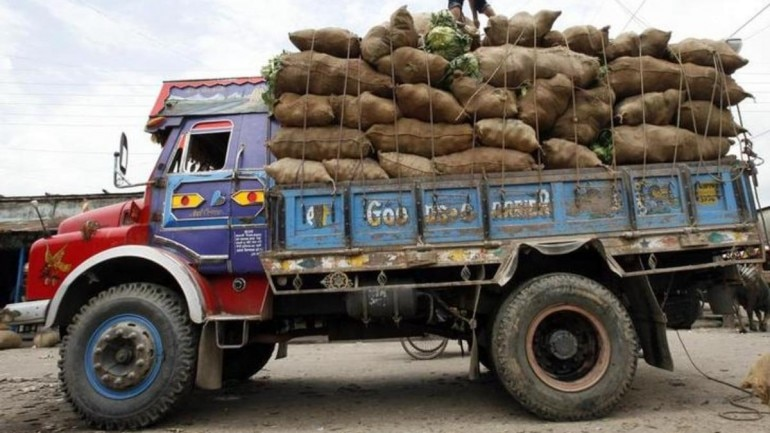 Image result for Truck owner from Rajasthan pays ₹1,41,700 challan for overloading
