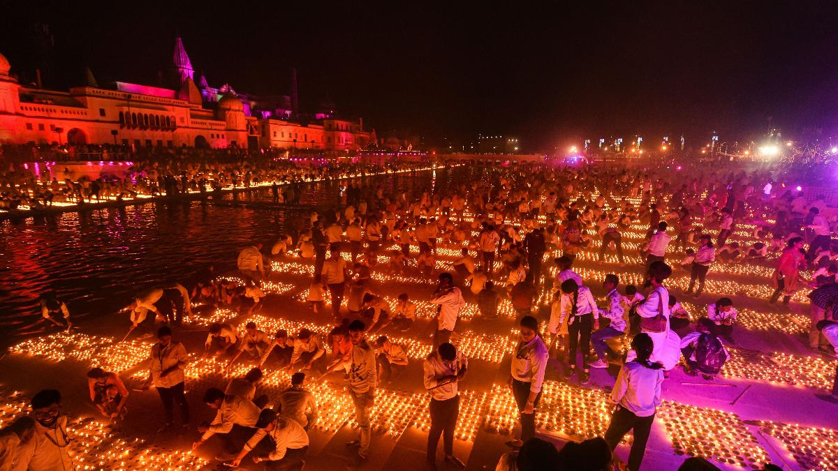 Image result for Record 6 lakh diyas lit on Saryu riverbank in Ayodhya on eve of Diwali