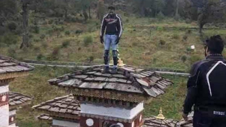 Indian biker arrested by Bhutan Police after video of him climbing memorial stupa sparks anger