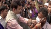 Delhi BJP chief Manoj Tiwari distributes masks in protest against AAP govt over air quality