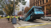 Bus falls backward into massive sinkhole in Pittsburgh. Terrifying pictures