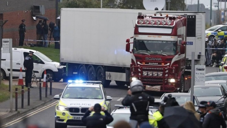 Police escort the truck, that was found to contain a large number of dead bodies, as they move it from an industrial estate in Thurrock, south England, Wednesday (AP Photo)