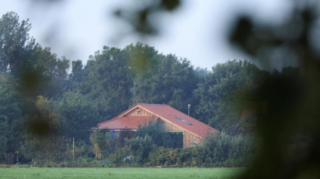 Man held after Dutch family found locked away in secret farmhouse room