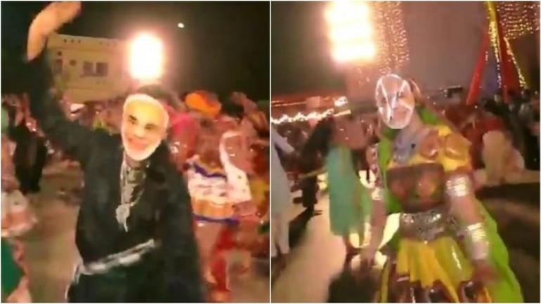 People play Garba in Surat with Modi masks on Photo: ANI