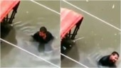Patna Floods: Man stranded in chest-deep water refuses to leave his rickshaw, breaks down. Viral video