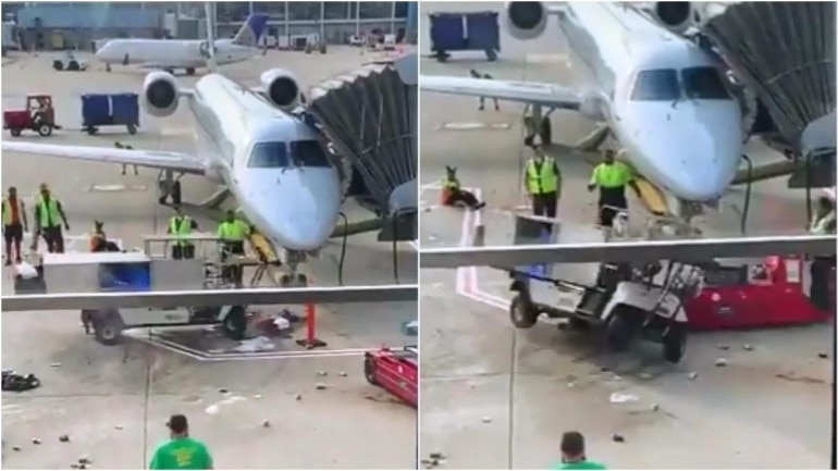 Catering cart almost hits a plane, ground staff saves the day Photo: Twitter/ Kevin Klauer