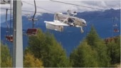 Plane crashes into ski lift in Italian Alps, gets entangled in overhead cables. Scary pics