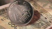 Rupee settles 14 paise down at 71.02 against dollar
