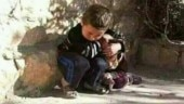 Fact Check: Photo showing Syrian child protecting his sister fudged as kids from Kashmir