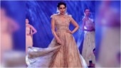 Karisma Kapoor glitters in a peach ball gown on the ramp. Pics are stunning