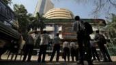 Sensex, Nifty close lower; stronger rupee hurts IT stocks