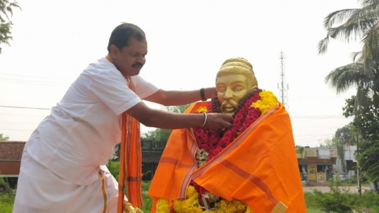 Image result for Why Thiruvalluvar statue wrapped with Saffron Cloth by Hindu Makkal Katchi?